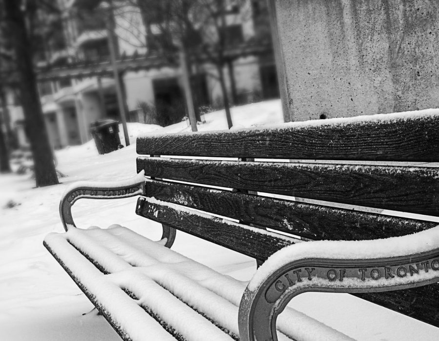 monochrome-photography-of-bench-covered-with-snow-894425.jpg